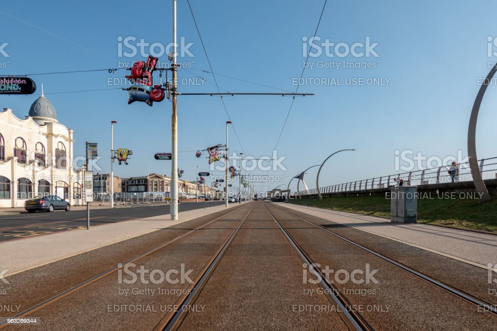 Tram lines along the seafront in Blackpool, curved lamp posts stock photo