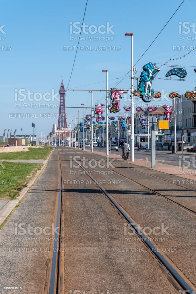 Tram lines along the seafront in Blackpool, Tower in background stock photo