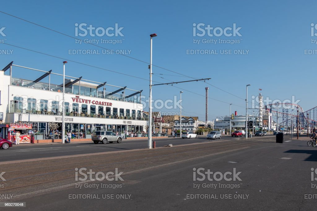 Tram lines along the seafront in Blackpool with a Wetherspoons pub stock photo