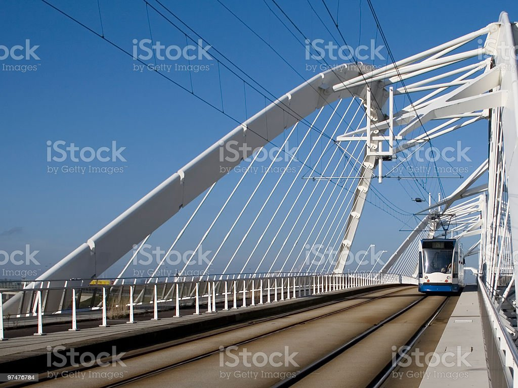 Tram on a modern bridge stock photo