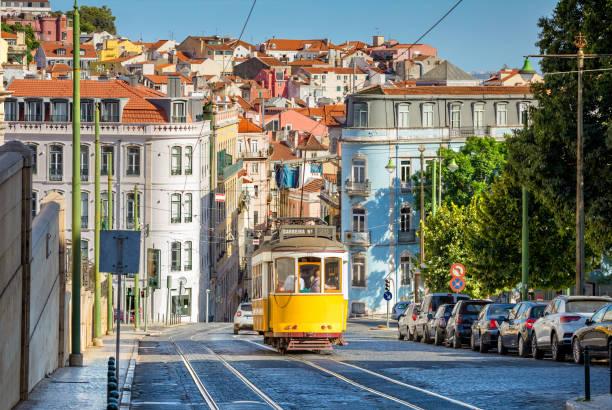 tram on line 28 in lisbon stock photo