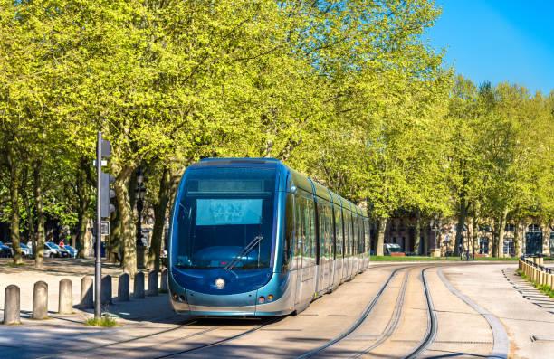 tram on quinconces square in bordeaux, france - linea tranviaria foto e immagini stock