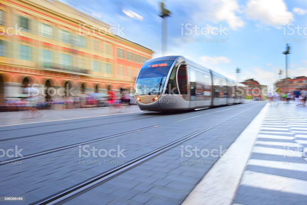 Tram, panning, motion and zoom blurred in Nice stock photo