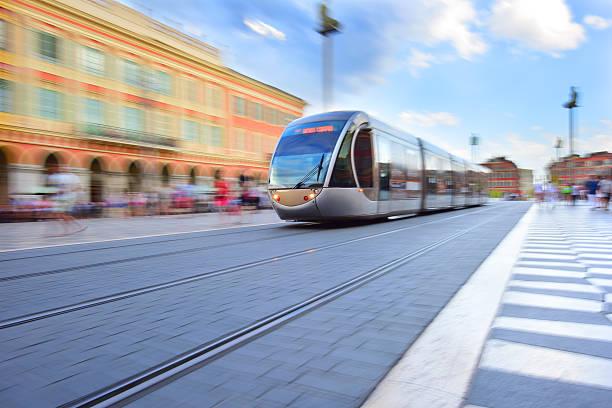 tram, panning, motion and zoom blurred in nice - spårvagn bildbanksfoton och bilder