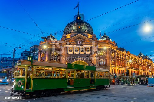 istock Tram passing Flinders Street Station at dusk 1198469814