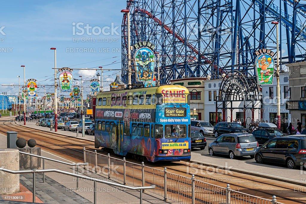 Tram Passing Funfair At Blackpool stock photo
