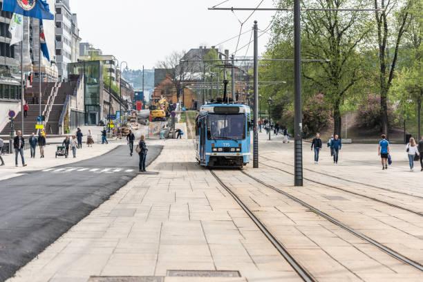 a tram passing in front of the city hall. - linea tranviaria foto e immagini stock