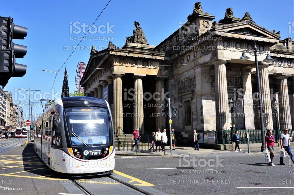 Tram passing Royal Scottish Academy stock photo