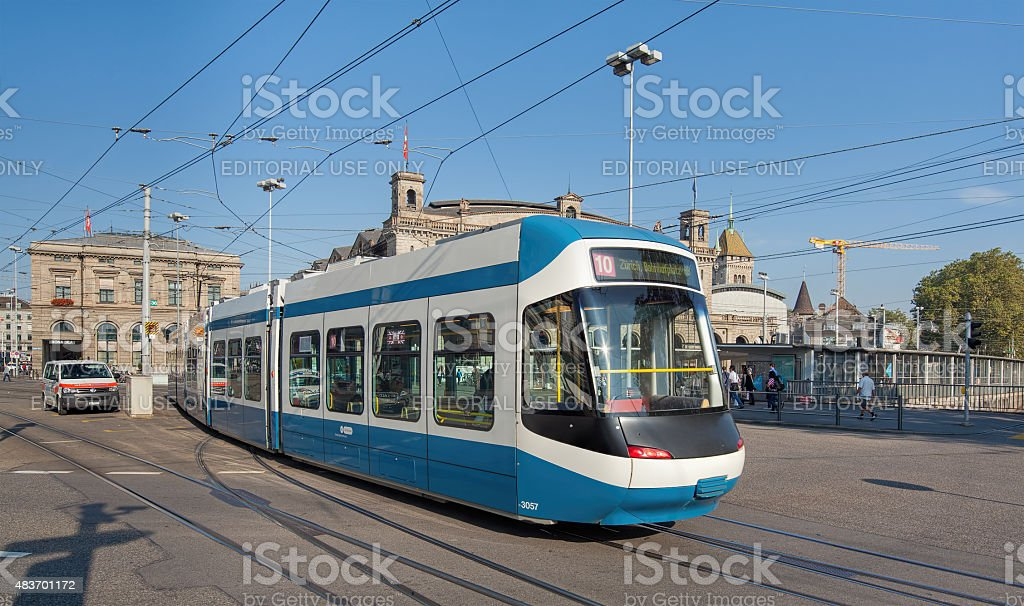 Tram passing the Bahnhofbruecke bridge stock photo