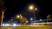 Izmir, Turkey - November, 2017: Tram passing trough at night front of camera in Karsiyaka downtown in Izmir,Turkey.