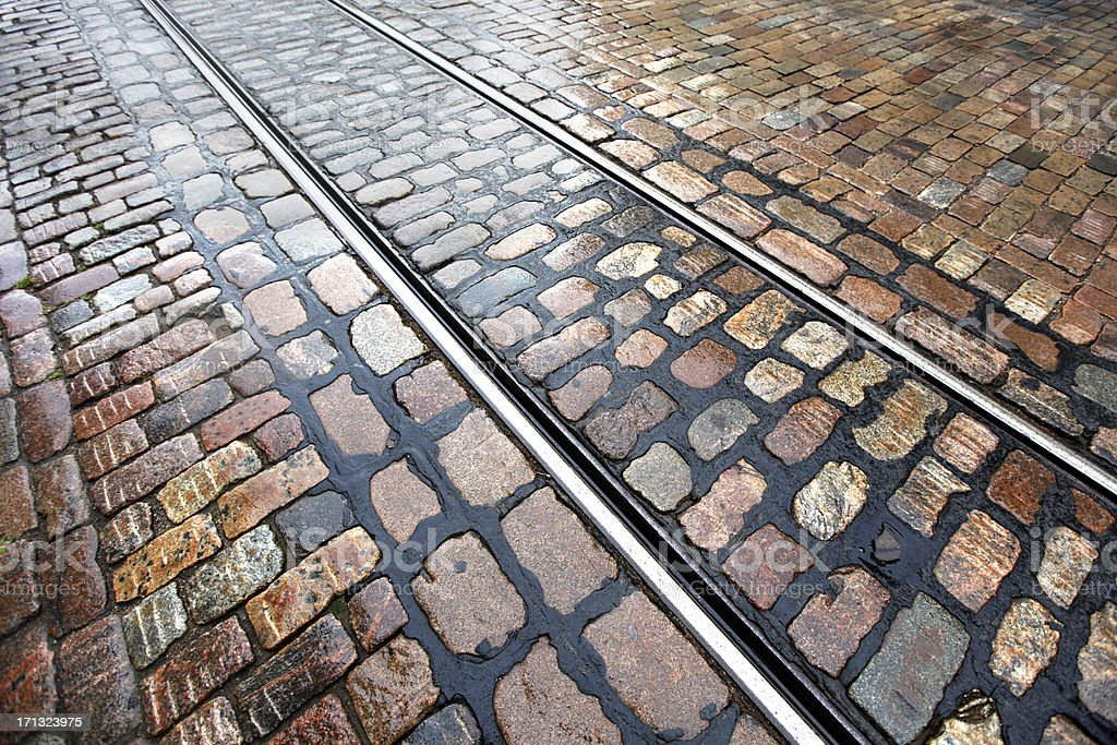 Tram rails on wet gobblestones royalty-free stock photo