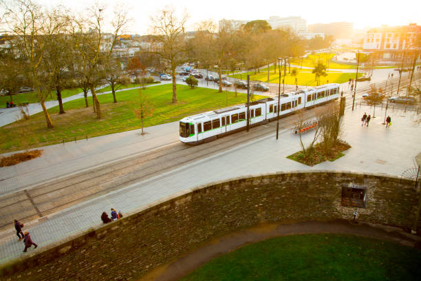 Tram rides through the city center of Nantes, France