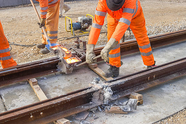 tram track construction site, tracks being joined - rail stock photos and pictures