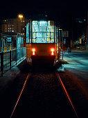 Back of tram, glowing lights
