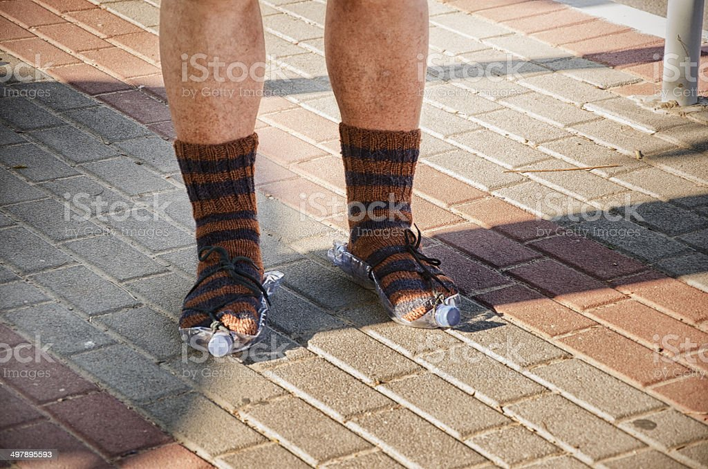 Tramp feet standing in knitted socks royalty-free stock photo