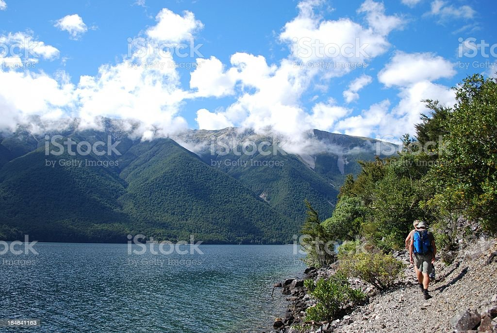 Trampers on Lake Rotoiti, Nelson Lakes, NZ stock photo