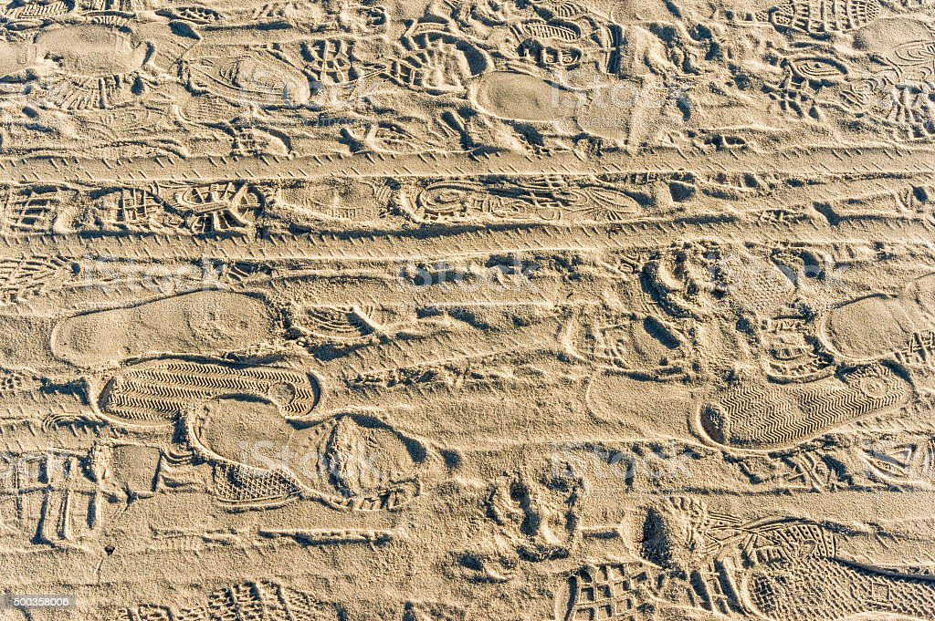 Trampled sand with urban footprints stock photo