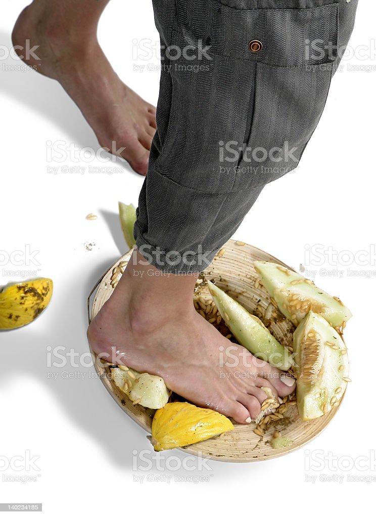 Trampling on fruits stock photo