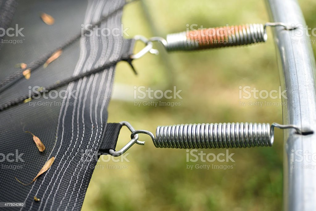 trampoline edge with rust and leaves stock photo