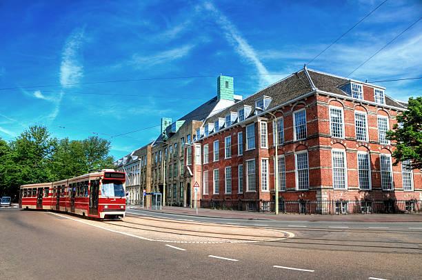 trams in the streets of amsterdam, netherlands - den haag stockfoto's en -beelden