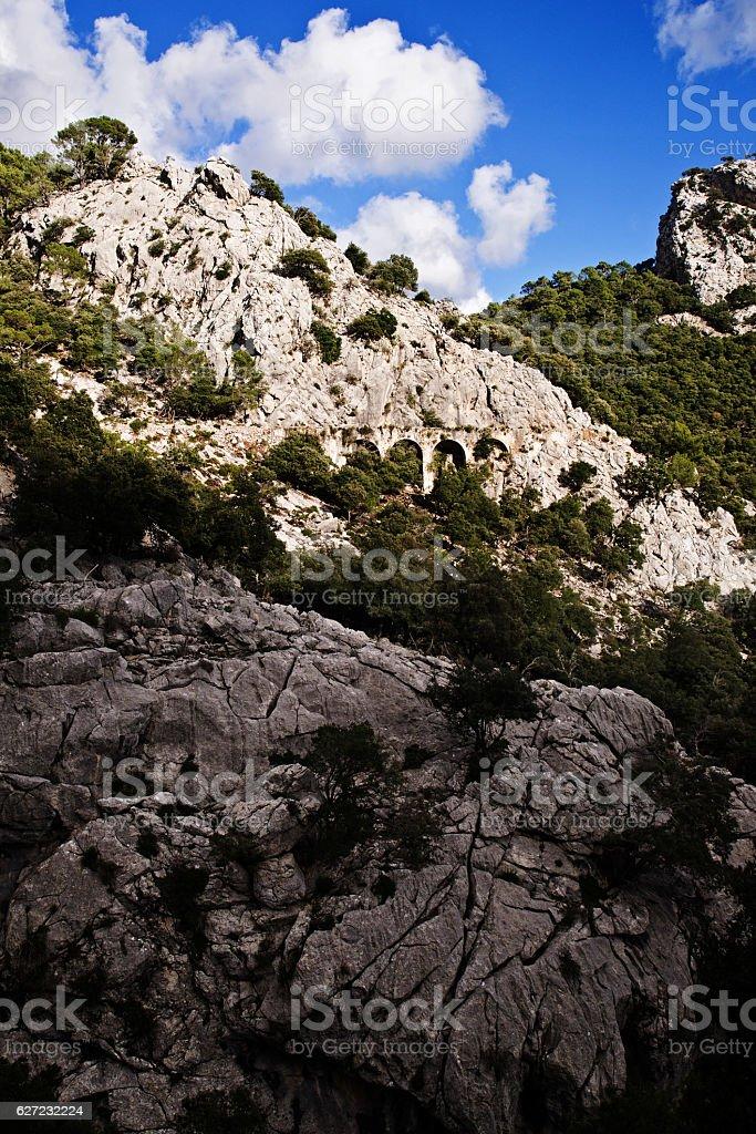 Tramuntana mountain range and historic aqueduct on Majorca island stock photo