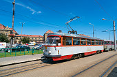 Arad, Romania - July 8, 2016: Arad  view showing tramway near in railway station building in Arad, street cars and pedestrians can be seen on the background