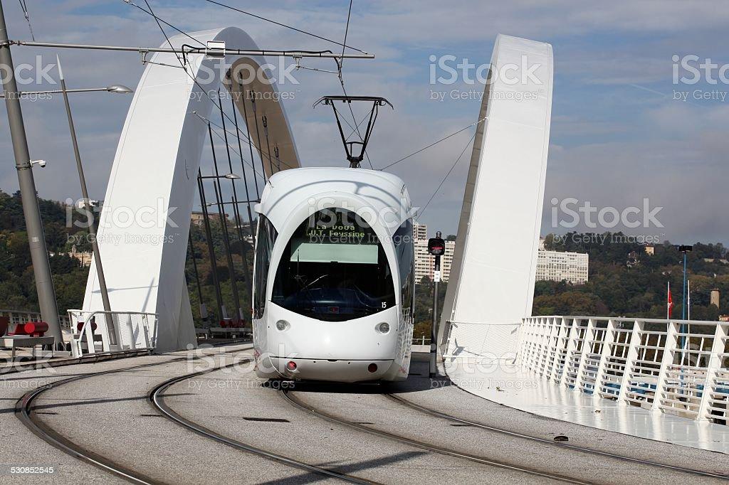 Tramway on a bridge near Confluence in Lyon stock photo