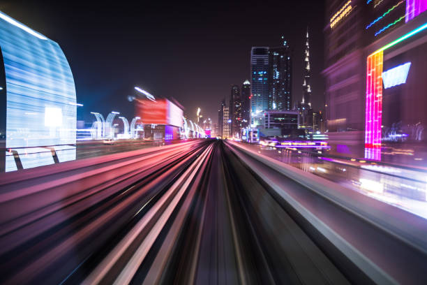 Tran running on rails in a night city. stock photo