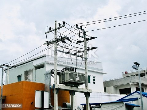 Chaos of Wires, Tranformer and Electric Wires on The Pole at Bangkok, Thailand.