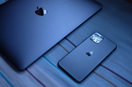 Trang,Thailand. October 24, 2019 : Customer lay down new macbook pro 2019 and iphone 11 pro are space grey colors on bed after receive from the apple store