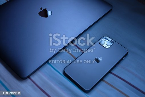 istock Trang,Thailand. October 24, 2019 : Customer lay down new macbook pro 2019 and iphone 11 pro are space grey colors on bed after receive from the apple store 1183532123