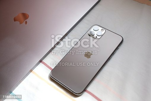 istock Trang,Thailand. October 25, 2019 : Customer lay down new macbook pro 2019 and iphone 11 pro are space grey colors on bed after receive from the apple store 1183519453