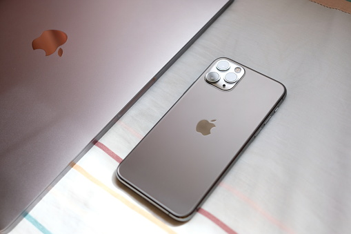 Trang,Thailand. October 25, 2019 : Customer lay down new macbook pro 2019 and iphone 11 pro are space grey colors on bed after receive from the apple store