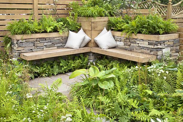 tranquil area in a garden - naturstein terrasse stock-fotos und bilder