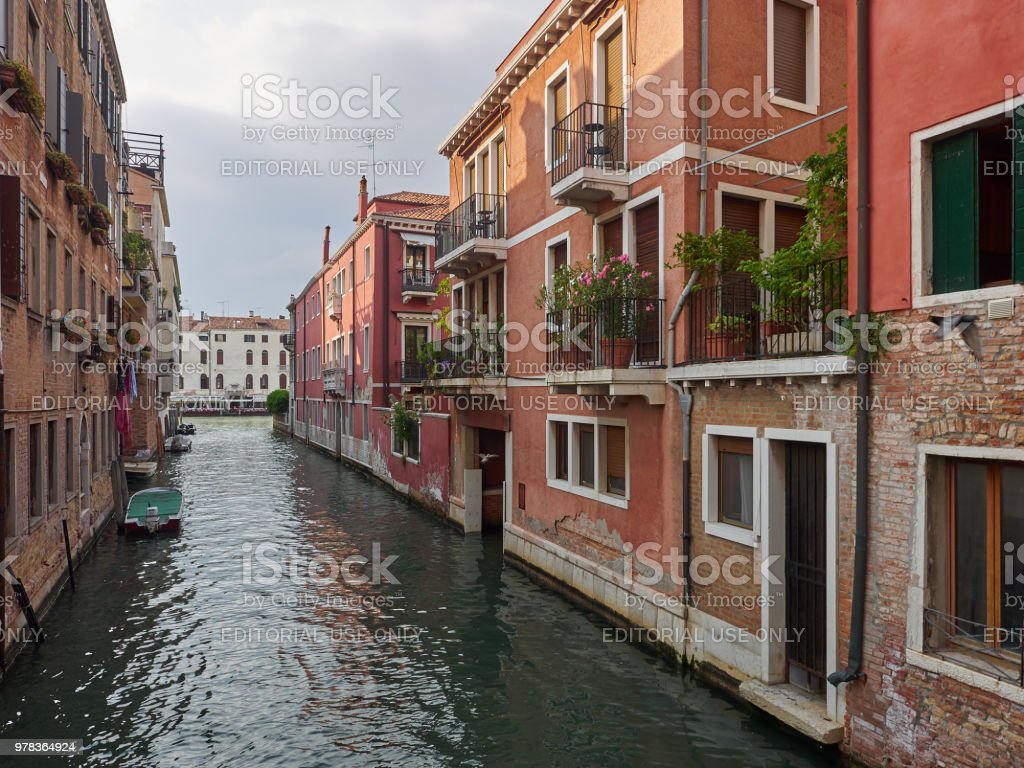 Tranquil back canal with colorful houses, Venice stock photo