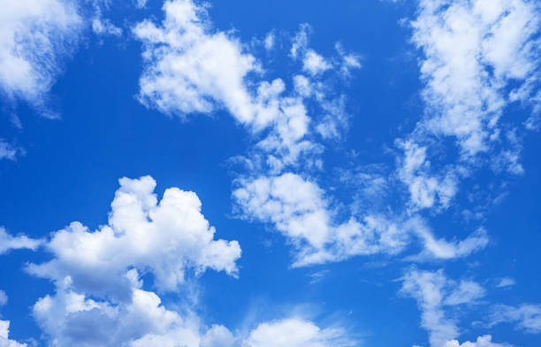 Tranquil clouds on blue sky stock photo
