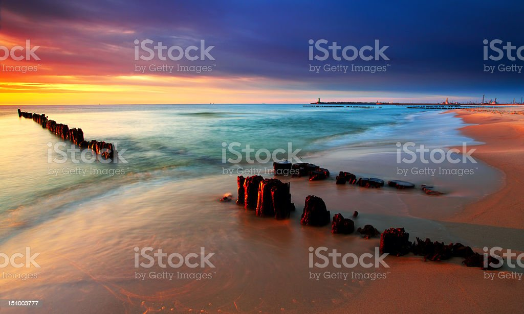 Tranquil Coastal Sunset on the Baltic sea beach stock photo