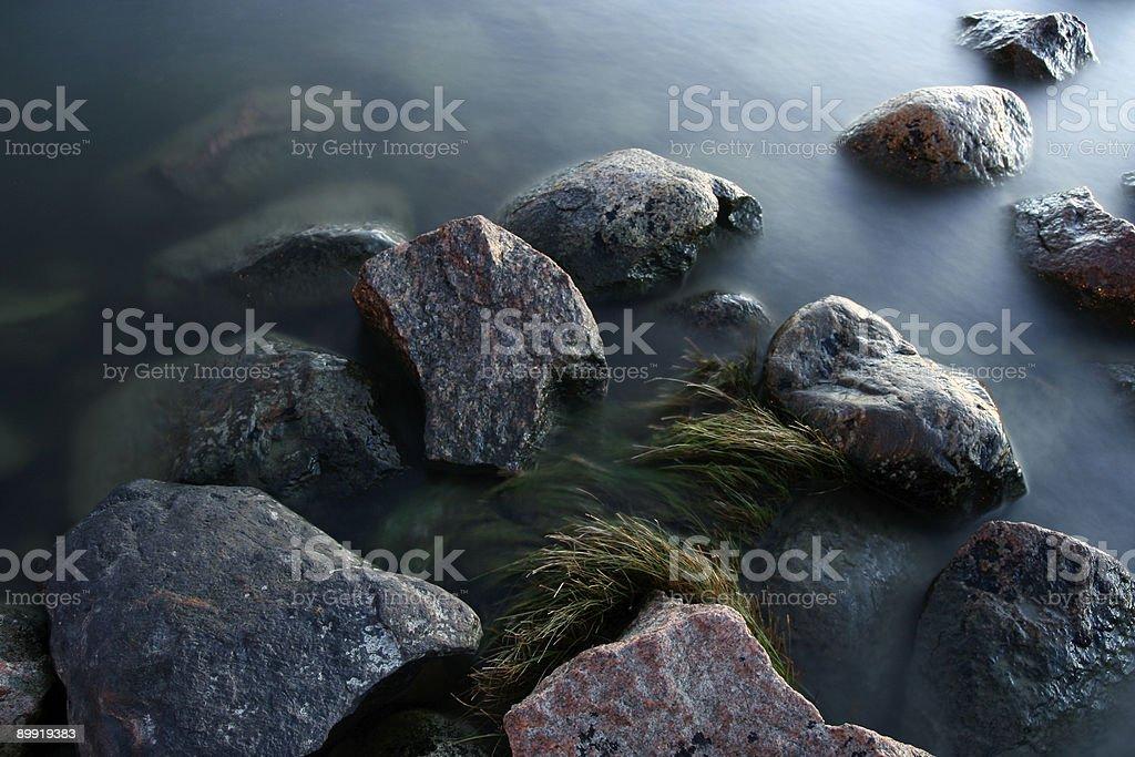 Tranquil coastline stones royalty-free stock photo