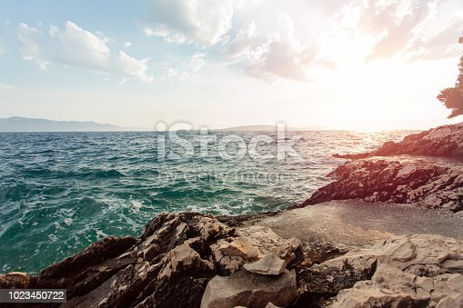 istock Tranquil, colorful sunset over the rocky coast of Adriatic sea 1023450722