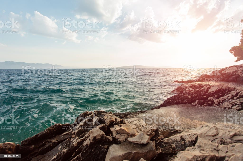 Tranquil, colorful sunset over the rocky coast of Adriatic sea stock photo