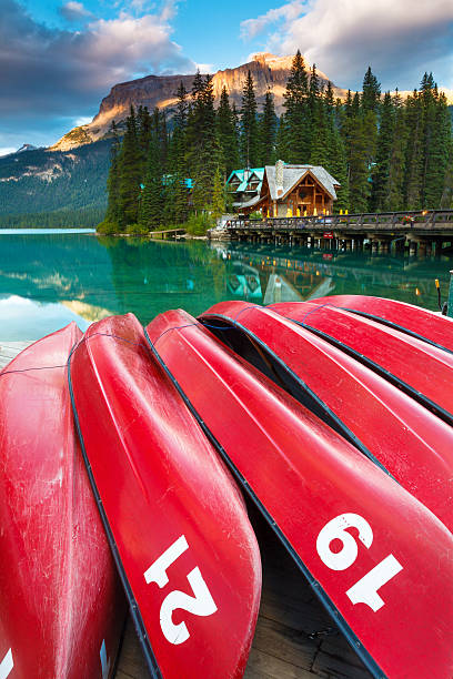 "Tranquil Emerald Lake ""Late summer afternoon at Emerald Lake in Yoho National Park, British Columbia, Canada. Emerald Lake is a major tourism destination in the Canadian Rockies."" emerald lake stock pictures, royalty-free photos & images"