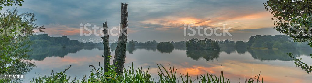 Tranquil evening lake reflection stock photo
