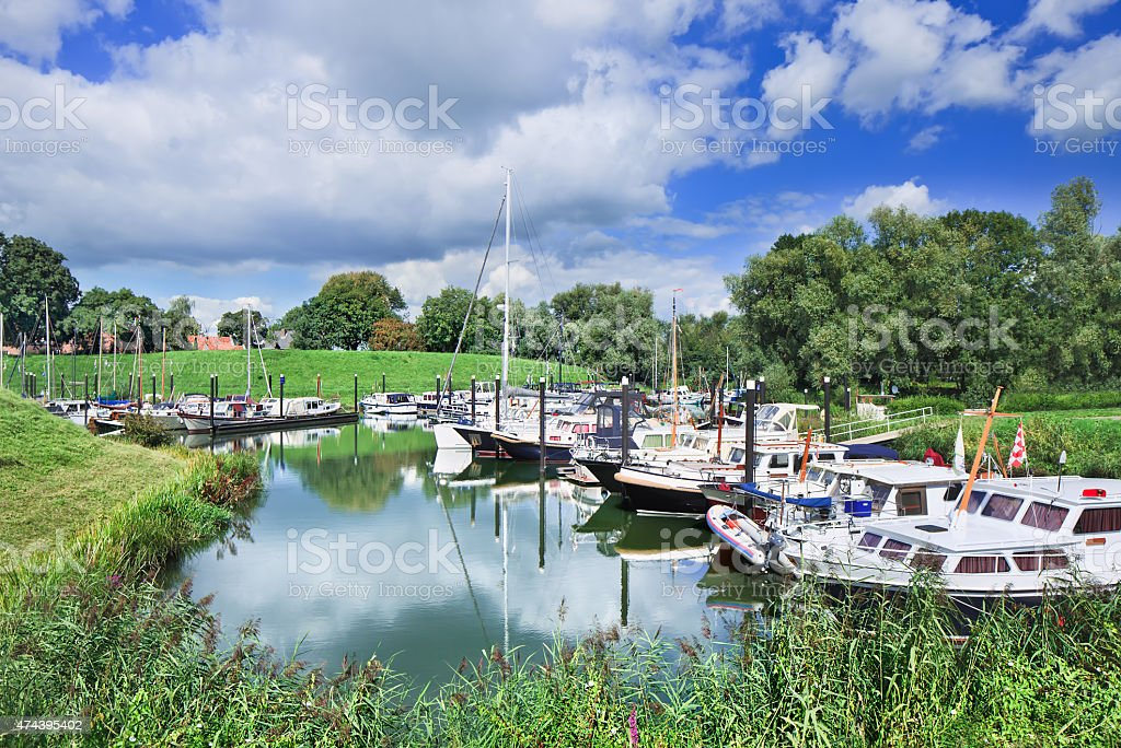 Tranquil harbor with yachts in green environment, The Netherlands stock photo