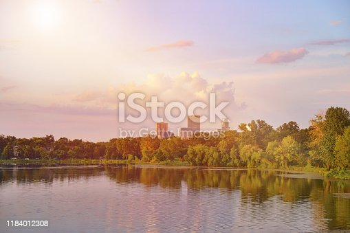 876420064 istock photo Tranquil lake at sunset with sunbeams 1184012308