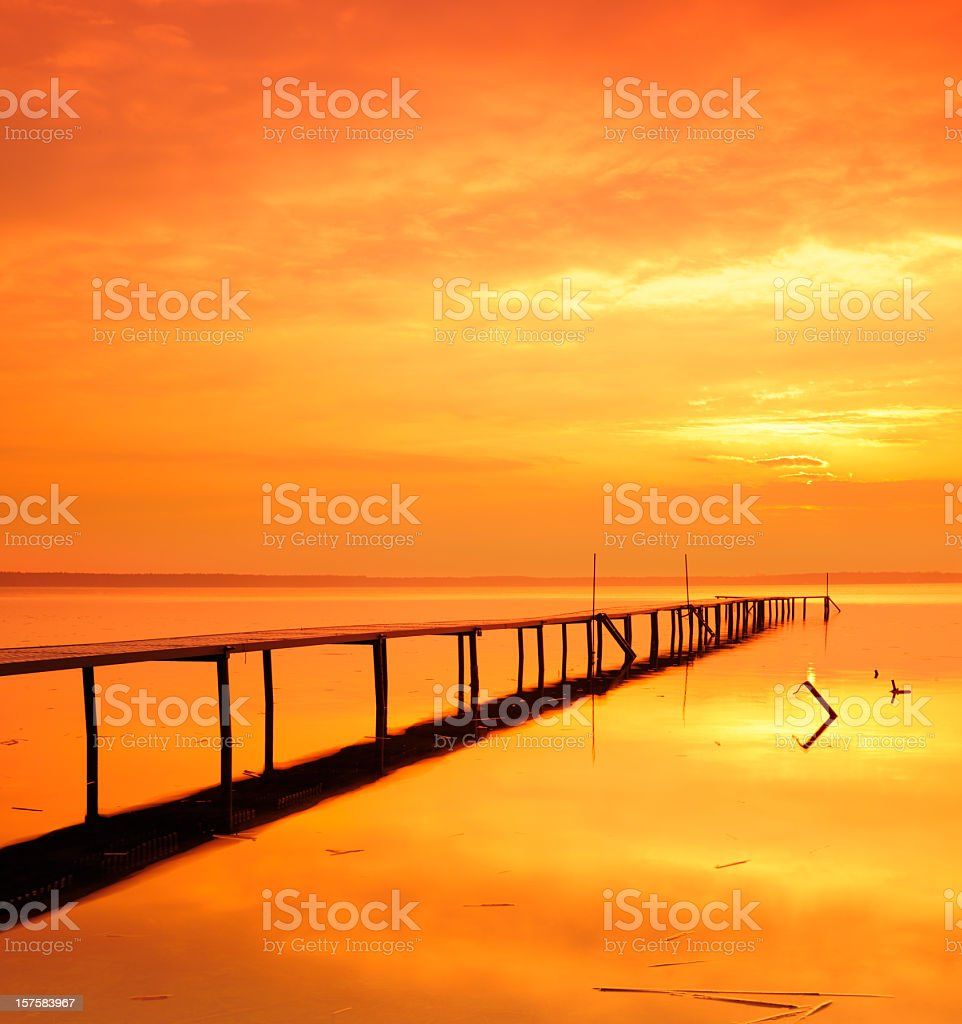 Tranquil Lake with Boardwalk Dock at Sunrise royalty-free stock photo
