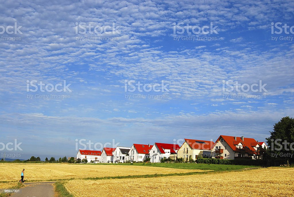 Tranquil landscape - hay fields and house range royalty-free stock photo