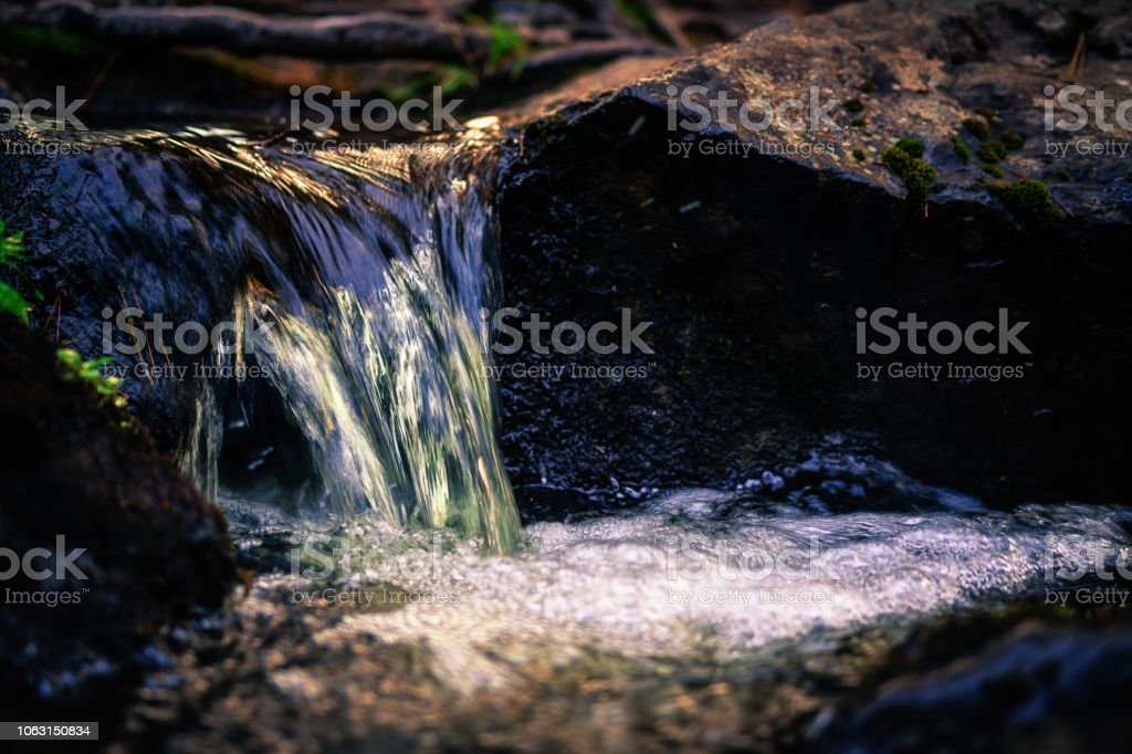 Tranquil Mini Waterfall. Intimate Landscape Background. stock photo