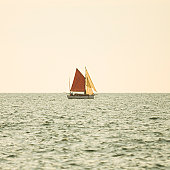 tranquil afternoon sailing on a old vintage sailboat