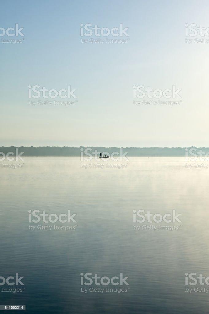 Tranquil scene of boat in calm lake stock photo