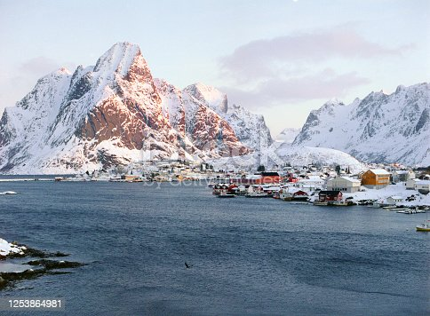 Tranquil scene of fishing village on Lofoten islands in winter. Camera film